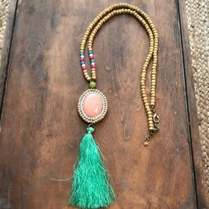 NWOT Long tassel and multi-colored bead necklace.